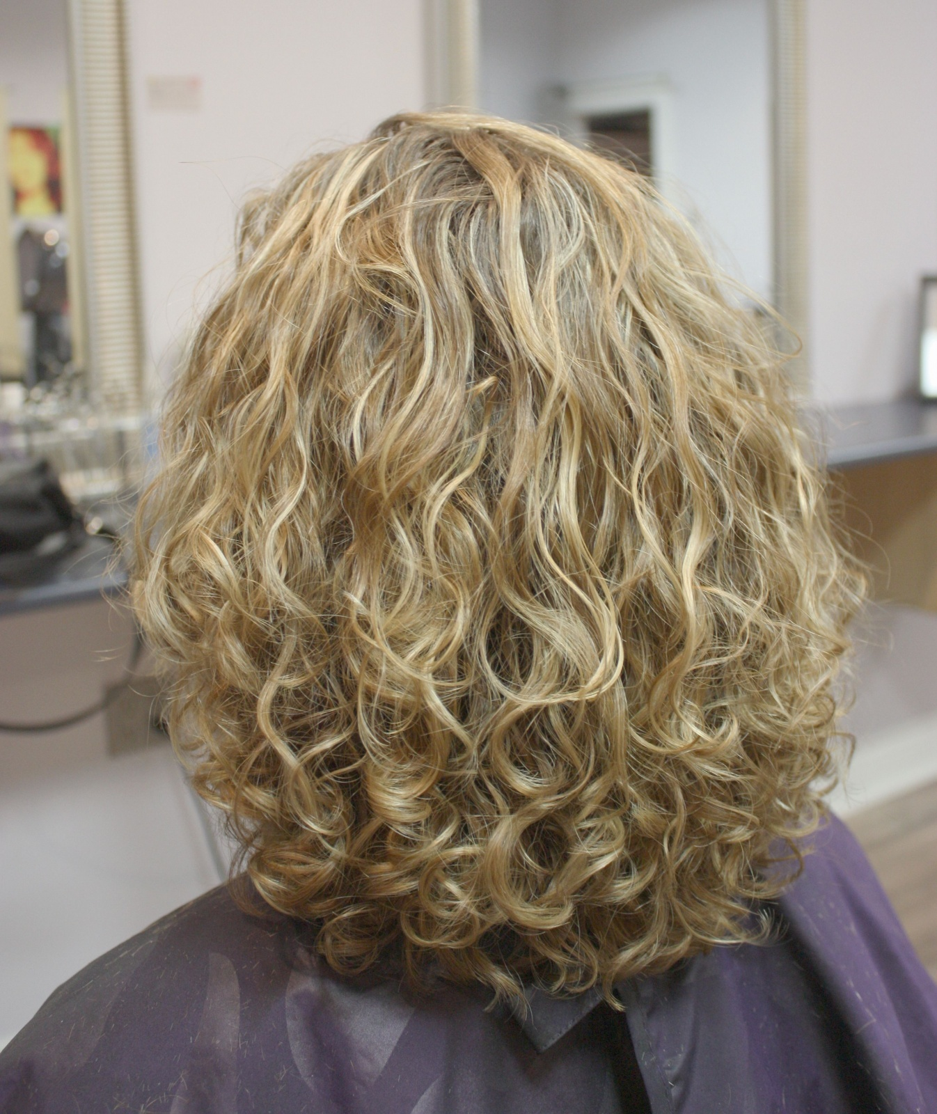 After image of colored and styled curly hair